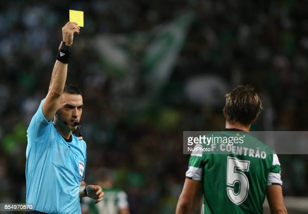 Sportings defender Fabio Coentrao from Portugal seeing yellow card during the match between Sporting CP v FC Barcelona UEFA Champions League playoff...