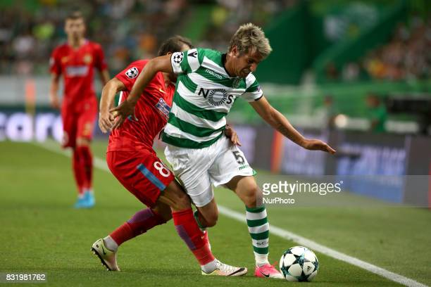 Sporting's defender Fabio Coentrao from Portugal vies with Steaua's midfielder Lucian Filip during the UEFA Champions League playoffs first leg...
