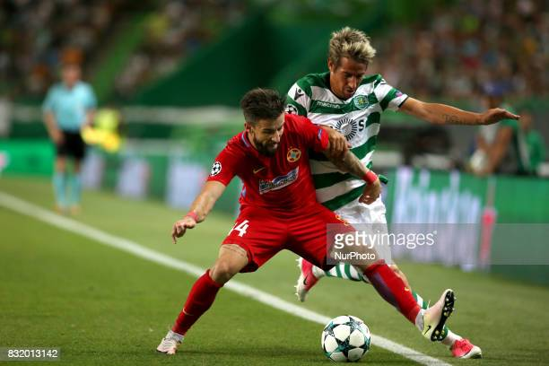 Sporting's defender Fabio Coentrao from Portugal vies with Steaua's midfielder Gabriel Enache during the UEFA Champions League playoffs first leg...