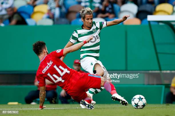 Sporting's defender Fabio Coentrao vies for the ball with Steaua's midfielder Gabriel Enache during Champions League 2017/18 first playoff round...