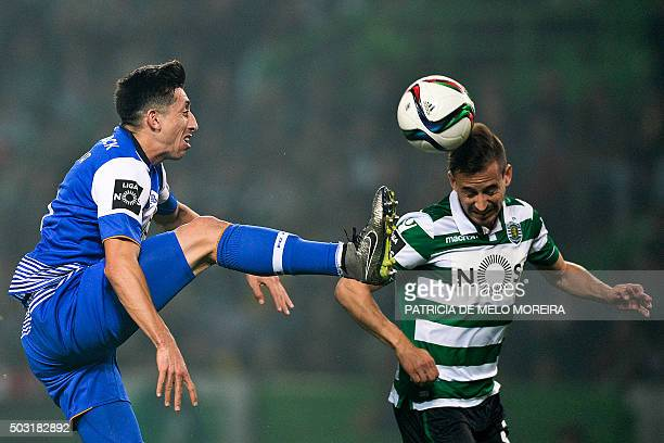 Sporting's defender Joao Pereira vies with Porto's Mexican midfielder Hector Herrera during the Portuguese League football match Sporting CP vs FC...