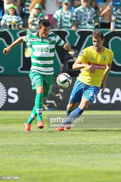 Sporting's defender Jonathan Silva vies with Estoril's forward Leo Bonatini during the Prmeira Liga match between Estoril and Sporting CP at Estadio...