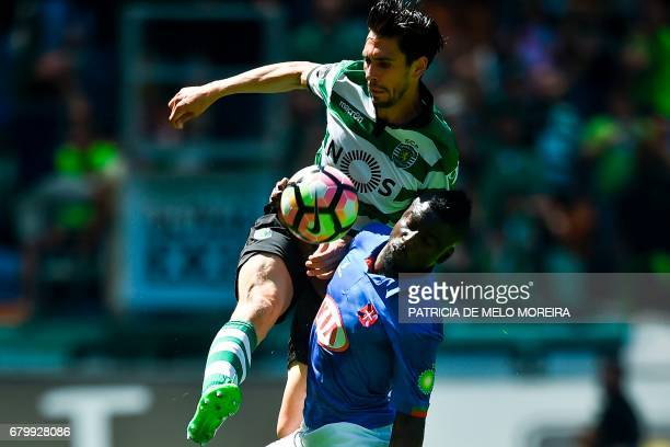 Sporting's defender Paulo Oliveira vies with Belenenses' forward Abel Camara during the Portuguese league football match Sporting CP vs OS Belenenses...