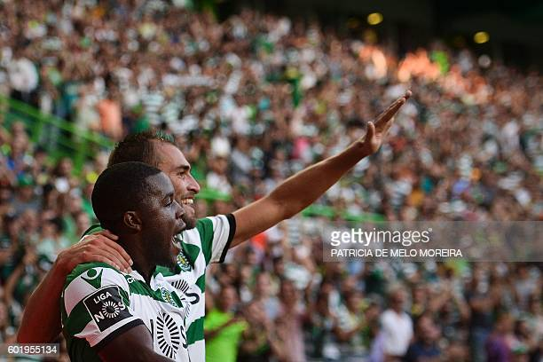 Sporting's Dutch forward Bas Dost celebrates a goal with teammate Costa Rican forward Joel Campbell during the Portuguese league football match...