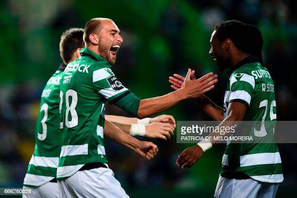 Sporting's Dutch forward Bas Dost celebrates with his teammate Sporting's defender Ruben Semedo after scoring during the Portuguese league football...