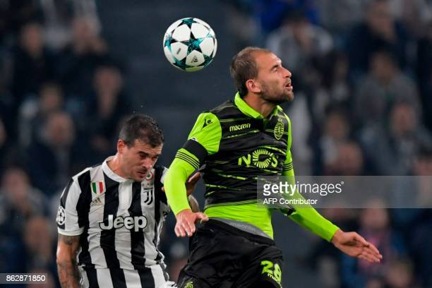 Sporting's Dutch forward Bas Dost fights for the ball with Juventus' midfielder from Italy Stefano Sturaro during the UEFA Champions League Group D...