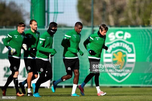 Sporting's Dutch forward Bas Dost French goalkeeper Romain Salin Portuguese goalkeeper Rui Patricio Portuguese midfielder William de Carvalho and...