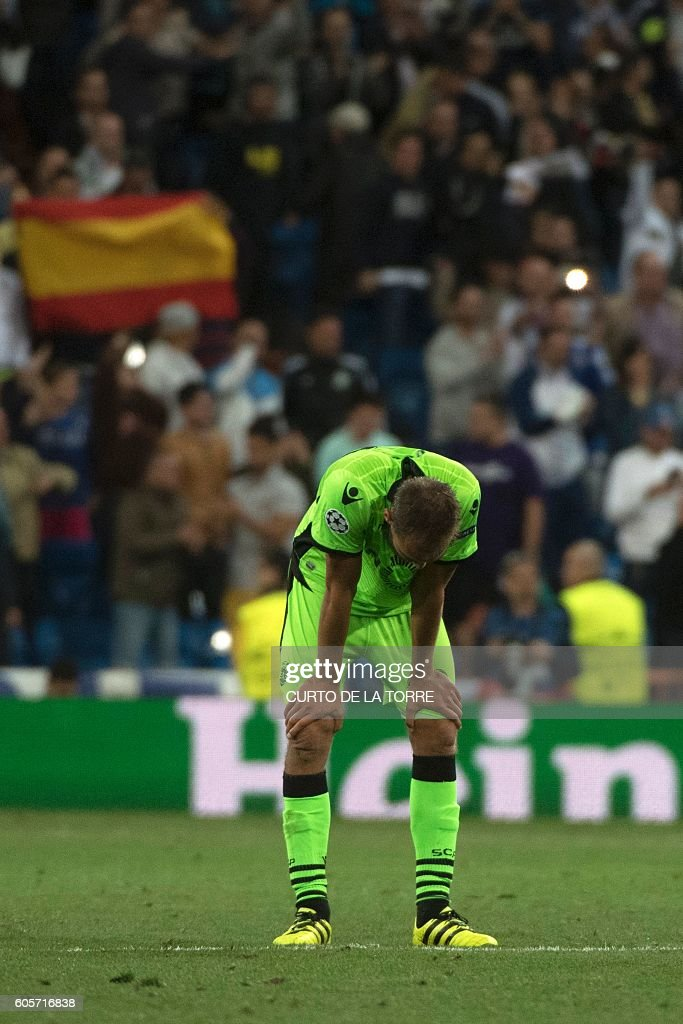 Sporting's Dutch forward Bas Dost reacts after Real Madrid scored their winning goal the UEFA Champions League football match Real Madrid CF vs Sporting CP at the Santiago Bernabeu stadium in Madrid on September 14, 2016. Real Madrid won 2-1. / AFP / CURTO