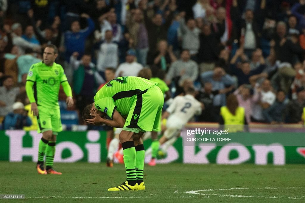 Sporting's Dutch forward Bas Dost reacts after Real Madrid scored their winning goal during the UEFA Champions League football match Real Madrid CF vs Sporting CP at the Santiago Bernabeu stadium in Madrid on September 14, 2016. Real Madrid won 2-1. / AFP / CURTO