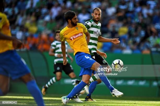 Sporting's Dutch forward Bas Dost vies with Estoril's defender Pedro Monteiro during the Portuguese league football match Sporting CP vs Estoril...