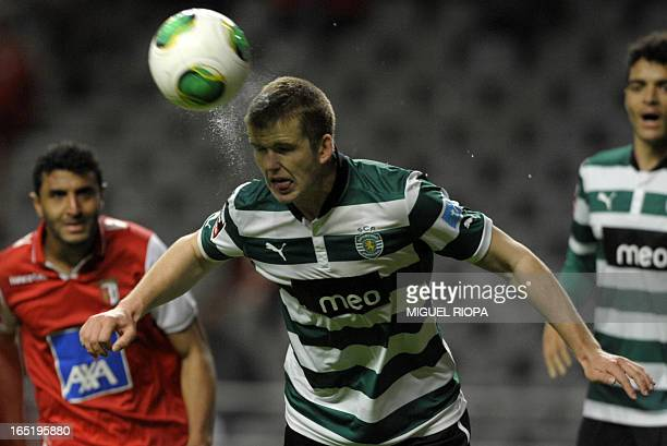 Sporting's English defender Eric Dier heads the ball next to Braga's Brazilian forward Carlao during the Portuguese league football match SC Braga vs...