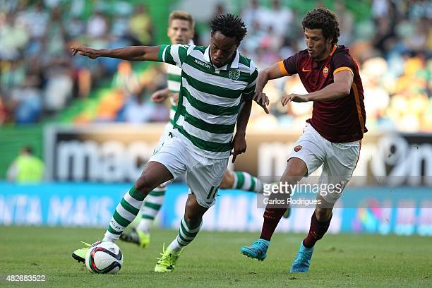 Sporting's forward Andre Carrillo vies with Roma's midfielder Ucan during the preseason friendly between Sporting CP and AS Roma at Estadio Jose...