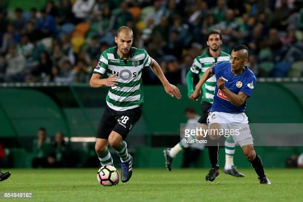 Sportings forward Bas Dost from Holland and Nacionals defender Victor Garcia from Venezuela during Premier League 2016/17 match between Sporting CP...