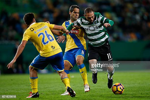 Sporting's forward Bruno Cesar vies for the ball with Arouca's midfielder Andre Santos and Arouca's forward Marlon de Jesus during Premier League...