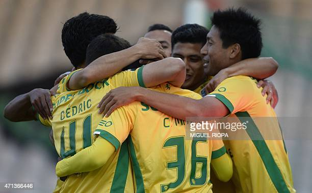 Sporting's forward Carlos Mane celebrates with teammates after scoring a goal during the Portuguese league football match Moreirense FC vs Sporting...