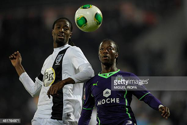 Sporting's forward Carlos Mane vies with Vitoria SC's Senegalese defender Abdoulaye Ba during the Portuguese league football match Vitoria Guimaraes...