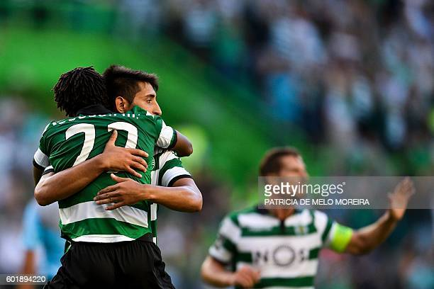 Sporting's forward Gelson Martins celebrates a goal with teammate Argentinian midfielder Alan Ruiz during the Portuguese league football match...