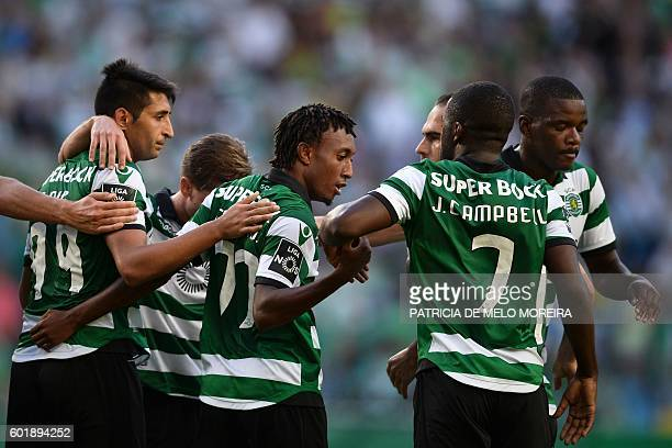 Sporting's forward Gelson Martins celebrates a goal with teammates during the Portuguese league football match Sporting CP vs Moreirense FC at the...