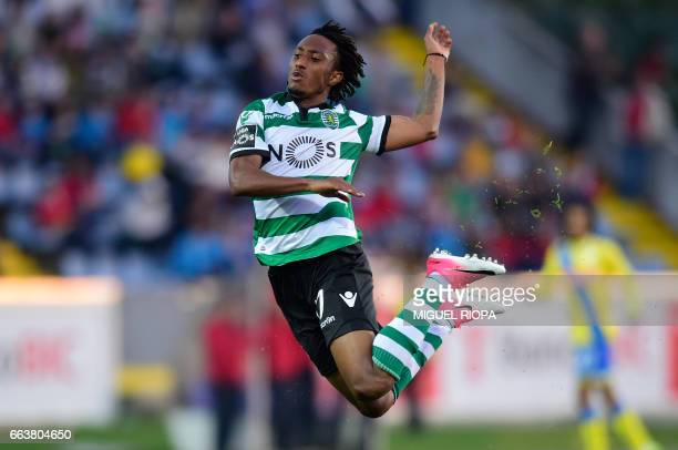 Sporting's forward Gelson Martins falls on the field during the Portuguese league football match Arouca FC vs Sporting CP at the Arouca Municipal...