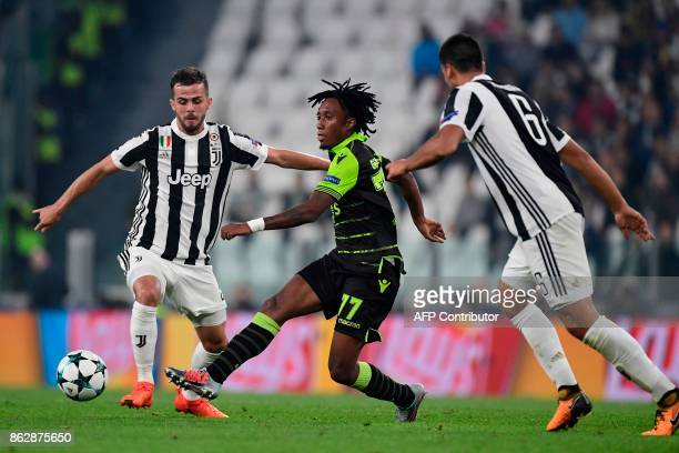 Sporting's forward Gelson Martins fights for the ball with Juventus midfielder Miralem Pjanic and Juventus' midfielder from Germany Sami Khedira...