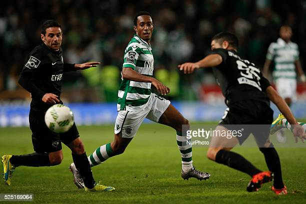 Sporting's forward Gelson Martins vies for the ball with Academica's midfielder Marinho and Academica's defender Rafa Soares during the Portuguese...