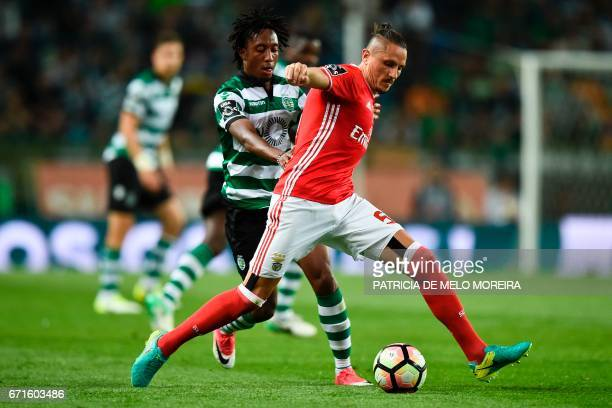 Sporting's forward Gelson Martins vies with Benfica's Serbian midfielder Ljubomir Fejsa during the Portuguese league football match Sporting CP vs SL...