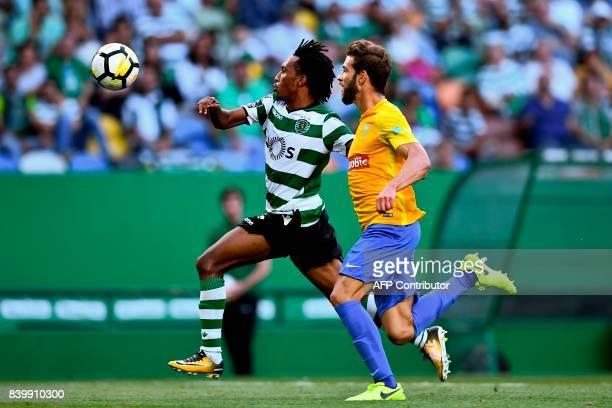 Sporting's forward Gelson Martins vies with Estoril's defender Joel Ferreira during the Portuguese league football match Sporting CP vs Estoril Praia...