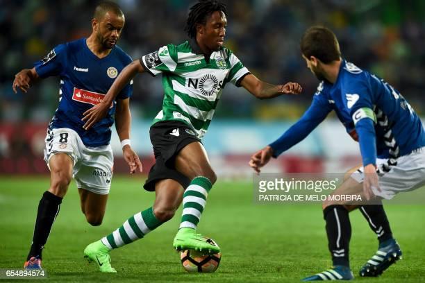 Sporting's forward Gelson Martins vies with Nacional's Brazilian midfielder Washington da Silva and Nacional's defender Rui Correia during the...