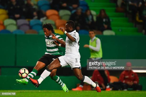 Sporting's forward Gelson Martins vies with Vitoria Guimaraes' Ivorian defender N'Clomande Konan during the Portuguese league football match Sporting...