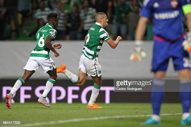 Sporting's forward Islam Slimani celebrates scoring a goal during the UEFA Champions League qualifying round playoff first leg match between Sporting...