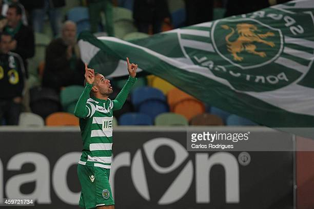Sporting's forward Islam Slimani celebrates scoring Sporting«s first goal during the Primeira Liga Portugal match between Sporting CP and Vitoria...