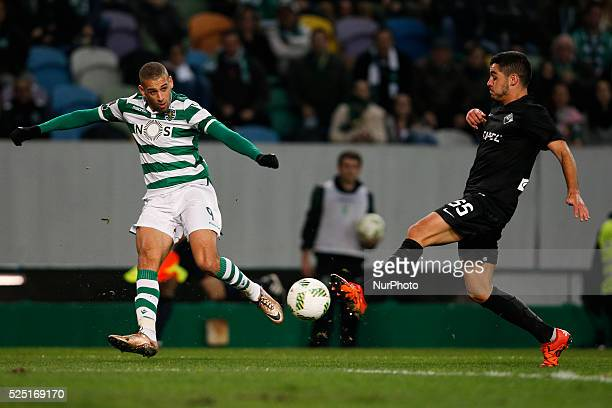 Sporting's forward Islam Slimani vies for the ball with Academica's defender Rafa Soares during the Portuguese League football match between Sporting...