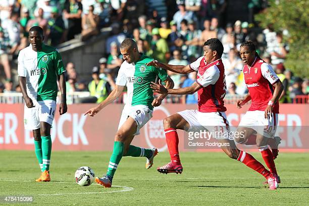 Sporting's forward Islam Slimani vies with Braga's defender Aderlan Santos during the Portuguese Cup Final between Sporting CP and SC Braga at...