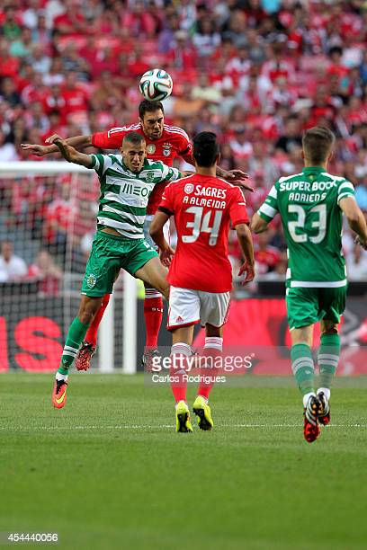 Sporting's forward Islam Sliming wins the ball during the Primeira Liga match between SL Benfica and Sporting CP at Estadio da Luz on August 31 2014...