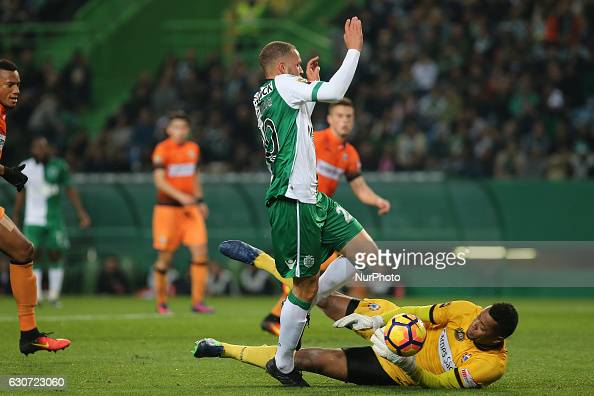 Sportings forward Luc Castaignos from Holland and Varzim SCs goalkeeper Paulo Vitor during Portuguese Cup 2016/17 match between Sporting CP and...