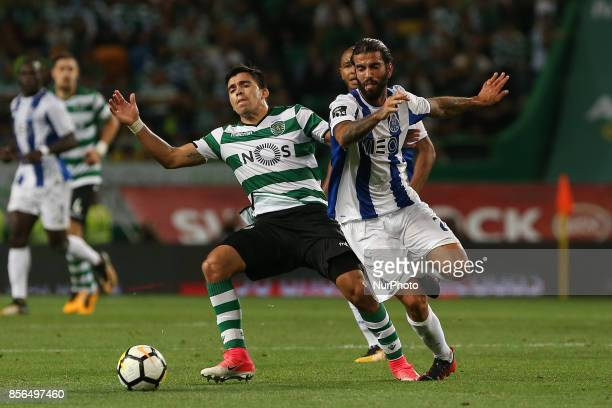 Sportings forward Marcos Acuna from Argentina and FC Portos midfielder Sergio Oliveira from Portugal during Premier League 2017/18 match between...