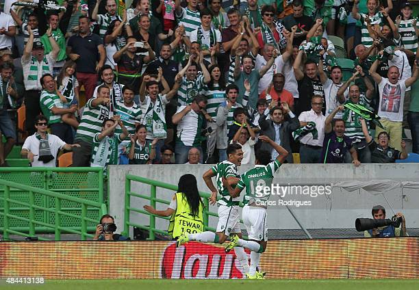 Sporting's forward Teofilo Gutierrez celebrates scoring a goal with Sporting's forward Andre Carrillo during the UEFA Champions League qualifying...