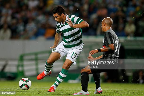 Sporting's forward Teofilo Gutierrez vies for the ball with Guimaraes's defender Bruno Gaspar during the Portuguese League football match between...