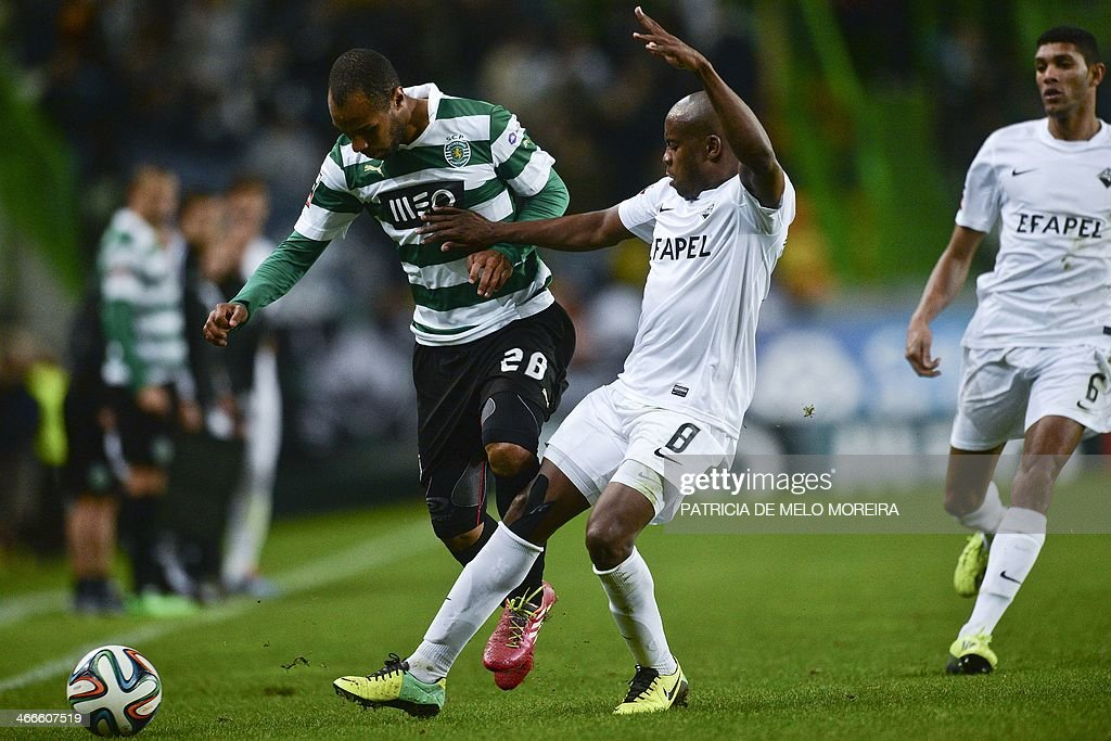 Sporting's forward Wilson Eduardo (L) vies with Academica's Brazilian midfielder Makelele during the Portuguese league football match Sporting vs Academica at the Alvalade stadium on February 2, 2014. The game ended in a draw 0-0. AFP PHOTO/ PATRICIA DE MELO MOREIRA