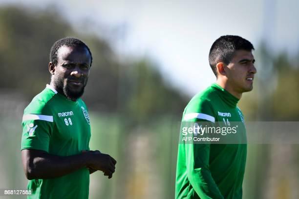 Sporting's Ivorian forward Seydou Doumbia and Sporting's Argentinian midfielder Rodrigo Battaglia arrive for a training session at the club's...