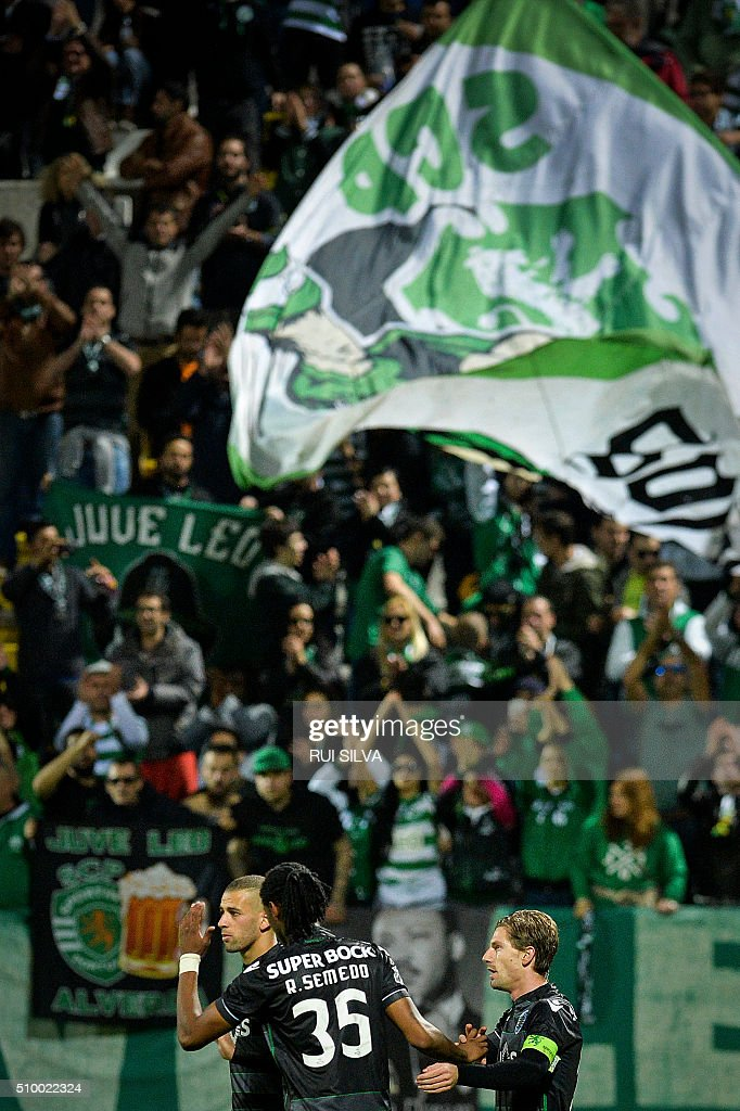 Sporting's midfielder Adrien Silva (R) celebrates a goal with teammates during the Portuguese league football match CD Nacional Funchal vs Sporting CP at the Madeira stadium in Funchal on February 13, 2016. / AFP / RUI SILVA