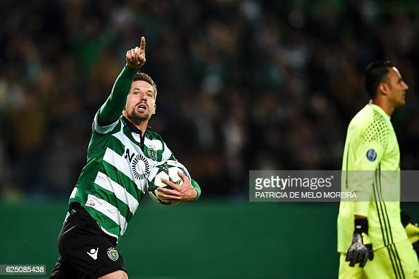 Sporting's midfielder Adrien Silva celebrates after scoring a penalty goal during the UEFA Champions League football match Sporting CP vs Real Madrid...