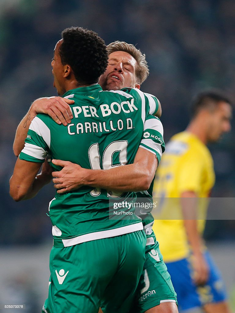 Sporting s midfielder Adrien Silva B celebrates his goal with