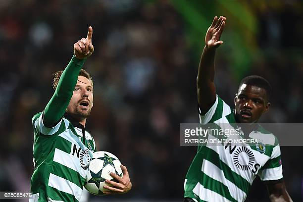 Sporting's midfielder Adrien Silva celebrates with his teammate Sporting's midfielder William de Carvalho after scoring a penalty goal during the...