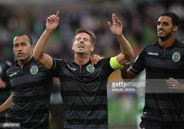 Sporting's midfielder Adrien Silva celebrates with teammates Brazilian defender Jefferson and Costa Rican forward Bryan Ruiz after scoring a goal...