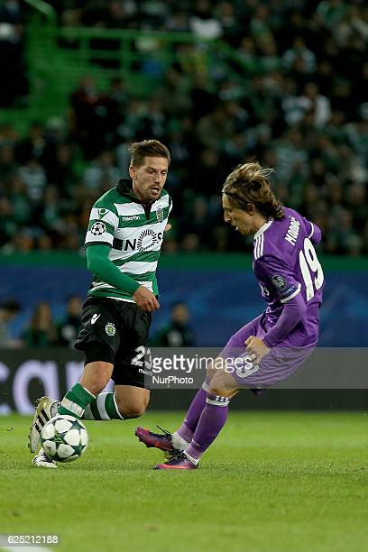 Sportings midfielder Adrien Silva from Portugal and Real Madrids midfielder Luka Modric from Croacia in action during the UEFA Champions League match...