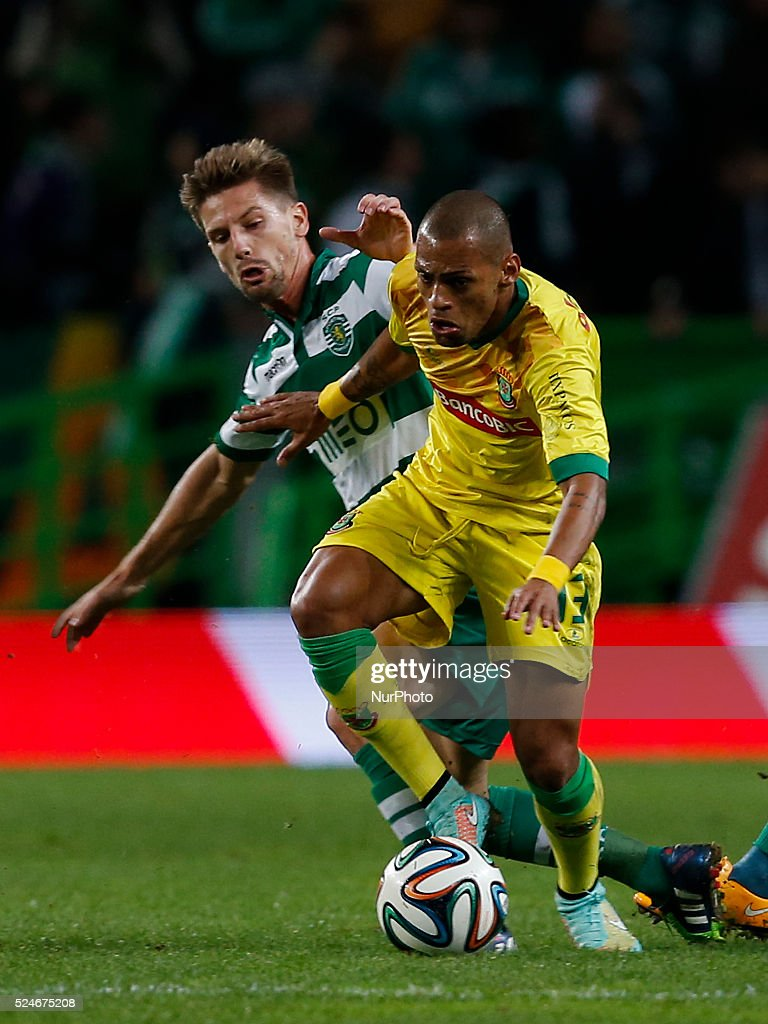Sporting s midfielder Adrien Silva L vies for the ball with