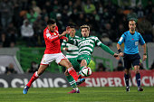 Sporting's midfielder Adrien Silva vies with Benfica's forward Eduardo Salvio during the Primeira Liga match between Sporting CP and SL Benfica at...