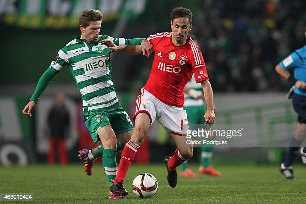 Sporting's midfielder Adrien Silva vies with Benfica's forward Jonas during the Primeira Liga match between Sporting CP and SL Benfica at Estadio...