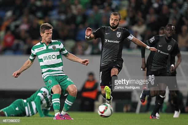 Sporting's midfielder Adrien Silva vies with Guimaraes's midfielder Andre Andre during the Primeira Liga Portugal match between Sporting CP and...